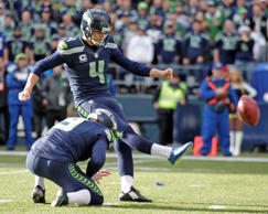 Seattle Seahawks kicker Steven Hauschka (4) kicks a field goal as Seahawks punter Jon Ryan holds in the first half of an NFL football game against the Arizona Cardinals, Sunday, Nov. 23, 2014, in Seattle.