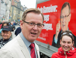 Bodo Ramelow, top candidate of German party 'Die Linke' (The Left) for the parliament elections in Thuringia state talks to supporters during an election campaign in Erfurt, Germany on Sept.12, 2014.