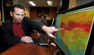 Anthony Guarino Jr., a seismic analyst at the California Institute of Technology, demonstrates an early earthquake warning system in Pasadena, Calif. The U.S. government has been testing an alert system in California that may someday warn residents and businesses that an earthquake has hit.