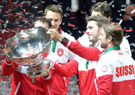 (L-R) Switzerland's Davis Cup team captain Severin Luthi and Switzerland's tennis players Marco Chiudinelli, Roger Federer, Stanislas Wawrinka and Michael Lammer celebrate after winning the Davis Cup tennis final against France at Stade Pierre Mauroy in Villeneuve-d'Ascq, northern France, on November 23, 2014. Roger Federer gave Switzerland its first Davis Cup title by defeating France's Richard Gasquet in straight sets in the first of the final's reverse singles.