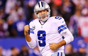 Tony Romo of the Dallas Cowboys celebrates throwing the game-winning touchdown pass in the fourth quarter against the New York Giants at MetLife Stadium on Nov. 23 in East Rutherford, NJ. The Cowboys defeated the Giants 31-28.