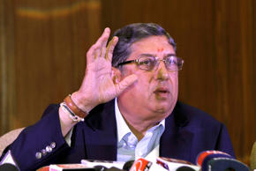India's cricket chief Narainswamy Srinivasan gestures during a press conference in Kolkata, India, Sunday, May 26, 2013.
