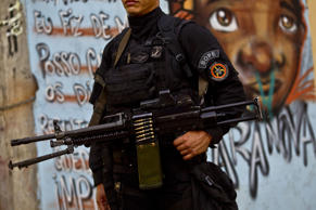 A member of the Special Police Operations Battalion, known by the local acronym BOPE, patrols the Mare favela in Rio de Janeiro, Brazil.
