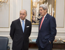 French Foreign Minister Laurent Fabius, left, and U.S. Secretary of State John Kerry talk as they meet at the residence of British ambassador in Vienna, Austria.