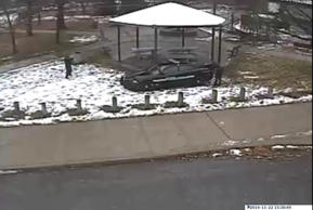 A police officer (L) is seen pointing his weapon during an incident involving the shooting of a 12-year-old boy with a pellet gun at the Cudell Recreation Center in Cleveland, Ohio, in this still image from video released by the Cleveland Police Department November 26, 2014.