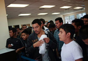 Illegal immigrants from Guatemala, who were deported from the U.S., wait while collecting their belongings from immigration officers.