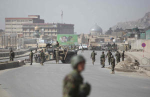 Afghan soldiers are seen at the blast site in Kabul, Afghanistan on March 9, 2013.