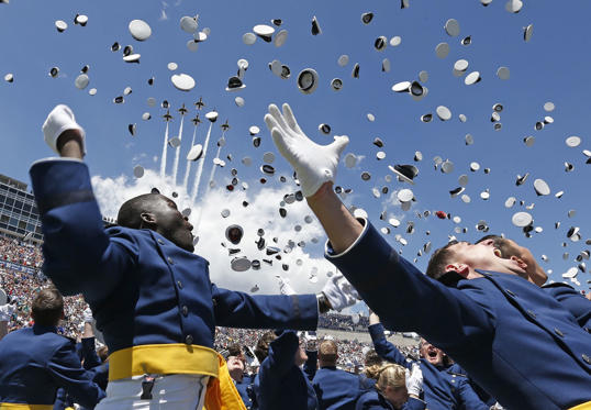 Air Force Academy graduates throw their caps into the air as F-16 jets from the Thunderbirds make a flyover, at the  completion of the graduation ceremony for the class of 2014, at the U.S. Air Force Academy, in Colorado on May 28.