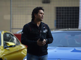 Former Indian cricketer Sachin Tendulkar looks on during a promotional event for an automaker at the Buddh International Circuit in Greater Noida, on the outskirts of New Delhi, on November 27, 2014. Batting icon Sachin Tendulkar led tributes in India on November 27 for Australian opener Phillip Hughes, calling the death of his former team-mate a 'sad day for cricket'.