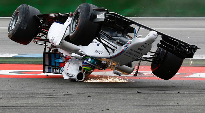 Williams Formula One driver Felipe Massa of Brazil crashes with his car in the first corner after the start of the German F1 Grand Prix at the Hockenheim racing circuit on July 20.