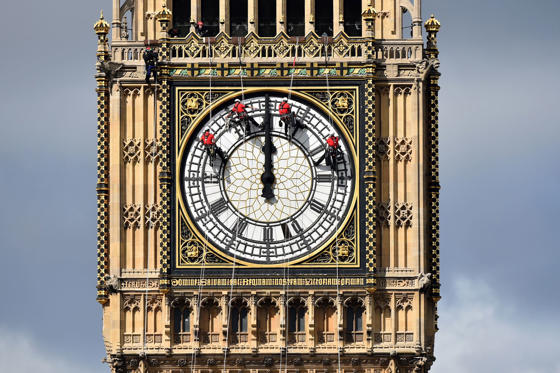 Technicians carry out cleaning and maintenance work on one of the faces of the Great Clock atop the landmark Elizabeth Tower that houses Big Ben, in London, on August 19.