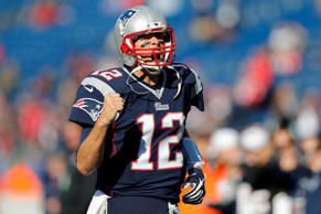 Nov 23, 2014; Foxborough, MA, USA; New England Patriots quarterback Tom Brady (12) pumps his fist as he takes the field before the game against the Detroit Lions at Gillette Stadium.