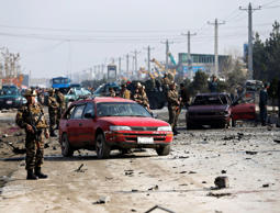Afghan security forces inspect the site of a suicide attack on a British embassy vehicle in Kabul, November 27, 2014.