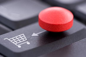 File: A red pill on a computer keyboard