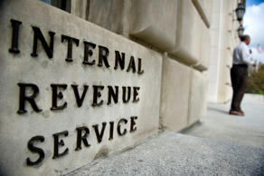 IRS employees exit the US Internal Revenue Service building at the end of the day in Washington, DC, on March 20, 2012.