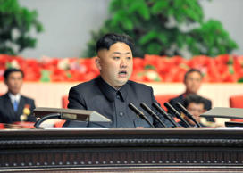 Kim Jong-un Attending a national meeting of light industrial workers.