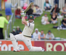 File: Australian batsman Phillip Hughes drives as he makes a solid start in Australia's second innings in the third day of play in the second test match in Hobart, Australia, Sunday Dec. 11, 2011.