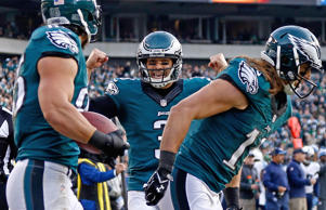(From left) James Casey of the Philadelphia Eagles celebrates a touchdown with teammates Mark Sanchez and Riley Cooper during a game against the Tennessee Titans on Nov. 23, 2014, in Philadelphia.