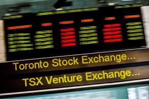 A sign board displaying Toronto Stock Exchange (TSX) stock information is seen in Toronto June 23, 2014.