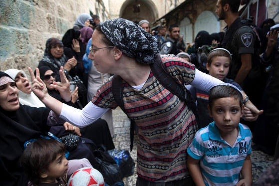 An Israeli woman, centre, and a Palestinian woman gesture at one another during a protest by Palestinian women against Jewish visitors to the compound known to Muslims as Noble Sanctuary and to Jews as Temple Mount in Jerusalem's Old City on October 14.