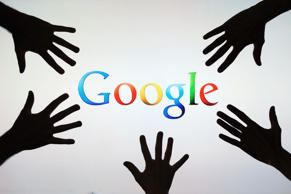 Google logo behind peoples hands