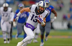 Ty Slanina #13 of the TCU Horned Frogs runs for a touchdown against the Kansas Jayhawks at Memorial Stadium on November 15, 2014 in Lawrence, Kansas.