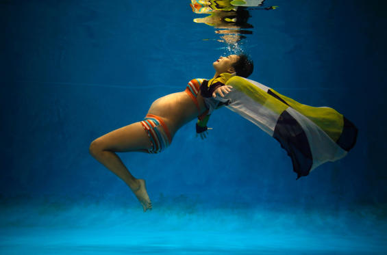 Jiejin Qiu, who is six months pregnant with her first baby, poses underwater during a photo shoot at a local wedding photo studio in Shanghai September 5. Qiu was photographed as part of a Reuters' project by Carlos Barria, who set-out to document a person born each year during China's one child policy. Ranging from a man born in 1979, to a baby born in 2014, Barria asked each of his subjects if they would have like to have siblings.