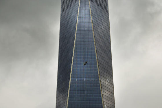 A scaffold carrying two workers hangs 69 floors up at One World Trade Center on November 12, in New York City. The workers were washing windows 69 floors up soon after One World Trade Center, the tallest building in the Western Hemisphere, opened.