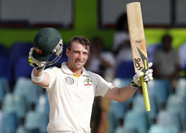 In this Sept. 19, 2011 file photo Australia's batsman Phillip Hughes celebrates after scoring a century during the third Test match between Australia and Sri Lanka in Colombo, Sri Lanka.