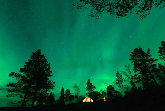 An Aurora Borealis is seen over a mountain camp north of the Arctic Circle, near the village of Mestervik late on  September 30.