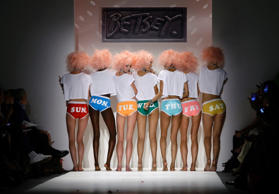 Models present creations from the Betsey Johnson Spring/Summer 2014 collection during New York Fashion Week on September 11.