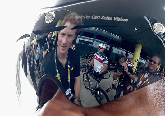 Prince Harry chats to a cycling competitor at the Invictus Games cycling at the velodrome at Queen Elizabeth park on September 13, 2014 in London, England.