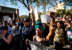 Protesters march in Oakland, California, against the shooting of Michael Brown, an unarmed black 18-year-old by a white police officer in Ferguson, Mo.