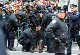 Unidentified people are arrested for alleged plans to disrupt Macy's Thanksgiving Day Parade over the Ferguson decision on November 27, 2014 on the streets of New York City.