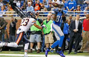 Detroit Lions wide receiver Calvin Johnson (81), defended by Chicago Bears cornerback Kyle Fuller (23), pulls in a 6-yard pass for a touchdown during the first half of an NFL football game in Detroit, Thursday, Nov. 27, 2014.