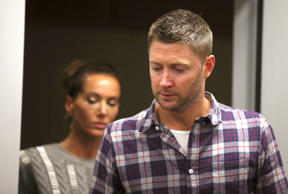 "Australia cricket captain Michael Clarke, right, and his wife, Kyly, arrive to a media briefing following the death of fellow cricketer Phillip Hughes during a press conference at St. Vincent's Hospital in Sydney, Thursday, Nov. 27, 2014. Hughes, 25, died in the hospital from a ""catastrophic"" injury to his head Thursday, two days after being struck by a cricket ball during a domestic first-class match."