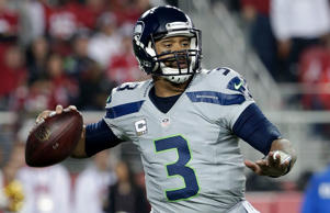 Seattle Seahawks quarterback Russell Wilson (3) passes against the San Francisco 49ers during the second quarter of an NFL football game in Santa Clara, Calif. on Nov. 27, 2014.