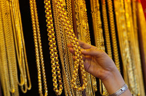 Gold prices drop sharply as Swiss referendum nears