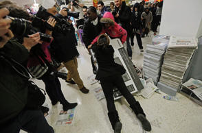 "Shoppers wrestle over a television as they compete to purchase retail items on ""Black Friday"" at an Asda superstore in Wembley, north London November 28, 2014. Britain's high streets, malls and online sites were awash with discounts on Friday as more retailers than ever embraced U.S.-style ""Black Friday"" promotions, seeking to kickstart trading in the key Christmas period."
