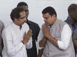 File: Maharashtra Chief Minister Devendra Fadnavis greets Shiv Sena Chief Uddhav Thackeray on occasion of second death anniversary of the late Balasaheb Thackeray at his memorial at Shivaji Park
