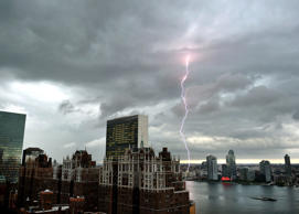 With the United Nations and Tudor City in the foreground, lightning strikes in the sky over the East River  as a major storm approaches New York City on July 2, 2014.