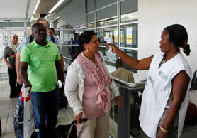 File: An Ivorian health worker from the National Public Health Institute screens for temperature international travellers arriving as a precaution to curb the spread of the deadly Ebola virus at the Felix Houphouet Boigny International airport in Abidjan, Ivory Coast