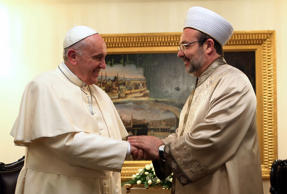 In this photo made available by Turkey's Religious Affairs Office, Pope Francis, left, and head of Turkey's Religious Affairs Mehmet Gormez speak during a meeting in Ankara, Turkey, Nov. 28, 2014. Under heavy security measures Pope Francis arrived in Turkey for a three-day visit.