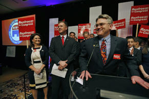 State Rep. Chris Holbert, right, speaks to Republican delegates, seconding the nomination of fellow legislator Scott Renfroe, left, during the state Republican congress, in Broomfield, Colo., Friday April 11, 2014.
