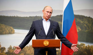 File: Russia's President Vladimir Putin gestures during a media conference after a G8 summit at the Lough Erne golf resort in Enniskillen, Northern Ireland June 18, 2013.