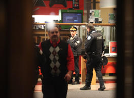 Chicago police secure the entrance to The Shops at North Bridge on Michigan Avenue that leads to the Nordstrom store in downtown Chicago, where two people were shot Friday, Nov. 28, 2014.