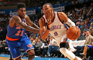 Russell Westbrook #0 of the Oklahoma City Thunder handles the ball against the New York Knicks on Nov. 28, 2014 in Oklahoma City, Okla.