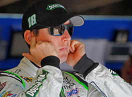 Kyle Busch looks from the garage area before practice for Saturday's NASCAR Bank of America 500 Sprint Cup Series auto race at Charlotte Motor Speedway in Concord, N.C., Thursday, Oct. 9, 2014.