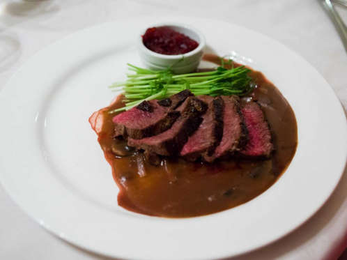Slide 51 of 51: WYOMING: Sample some game meats, like tender cuts of venison, elk chops, and bison burgers.