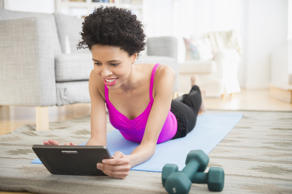 Woman working out with digital tablet